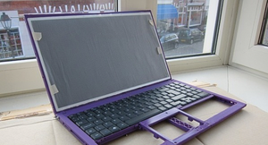 Figure 1: An early version of the laptop showing 3D-printed parts.